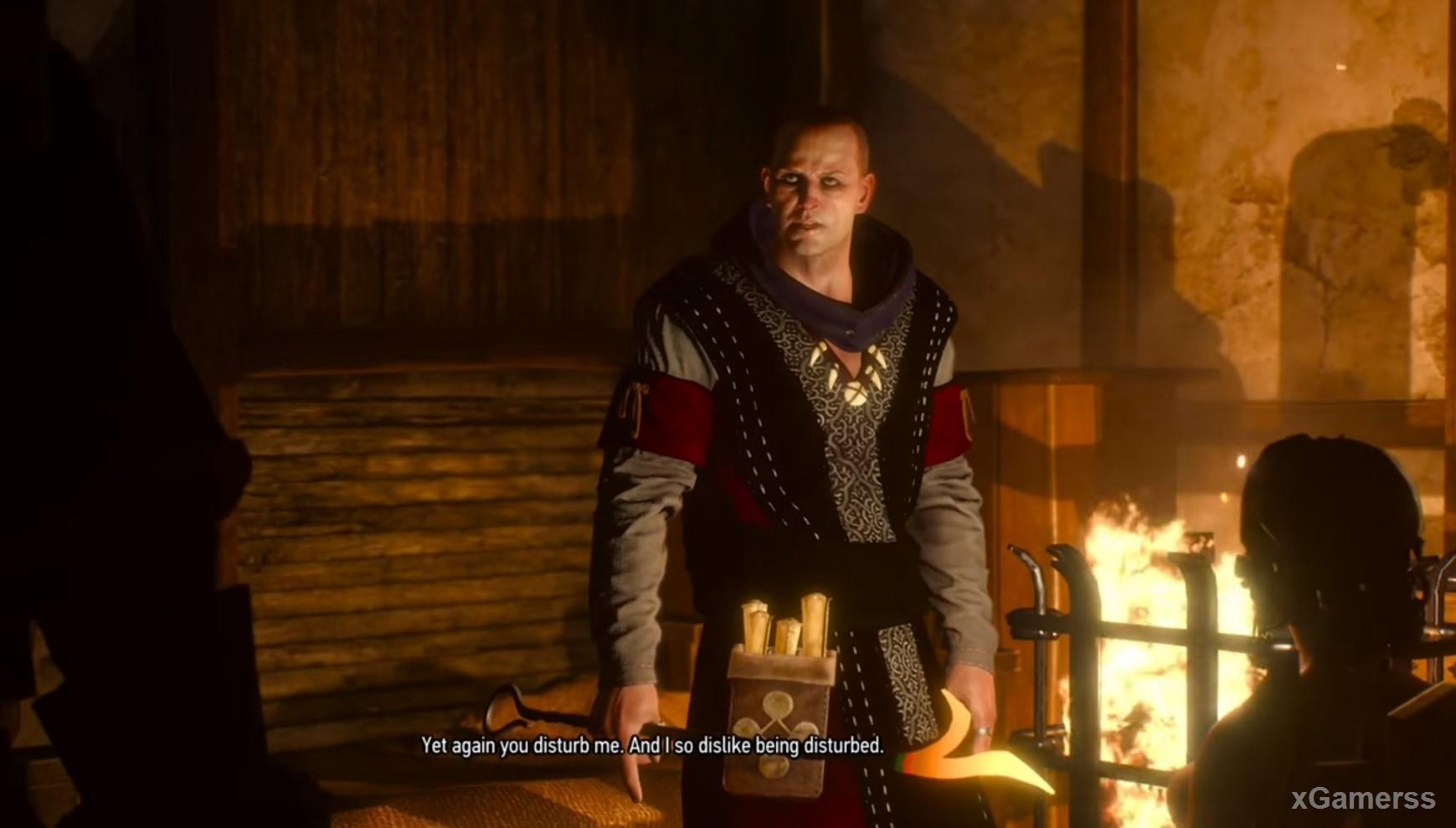 Geralt confronts the priest Pastodi with a red-hot poker